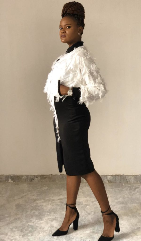 White feathery dress, bomber jacket style with front slit and front zipper