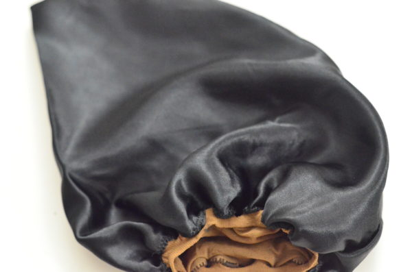 This is a satin lined wig cap. The satin protects the hair